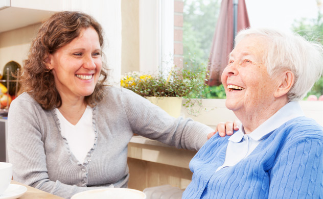 Visiting home carer with elederly woman